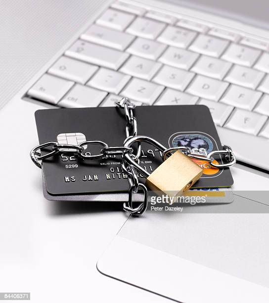 credit cards chained up with padlock - fraud protection stock pictures, royalty-free photos & images