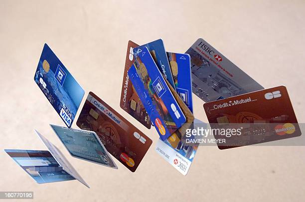 Credit cards falling down are pictured on February 5 2013 in Rennes western France French police has arrested early this morning in Paris and in...