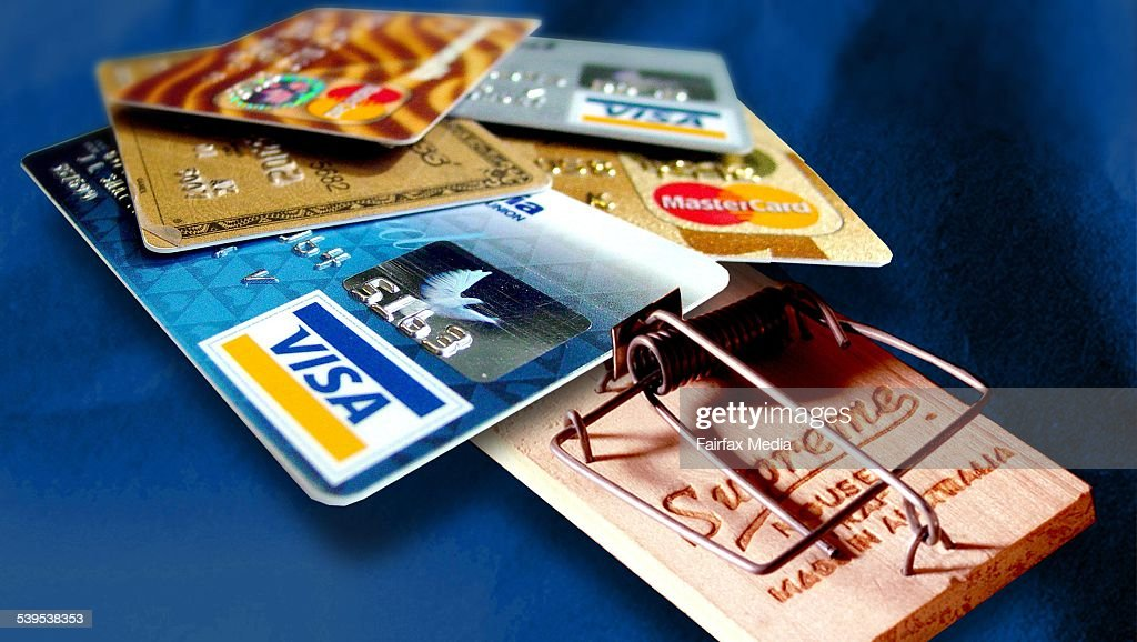 Credit cards in a mouse trap, 3 December 2003. AFR Picture by KARL HILZINGER : News Photo