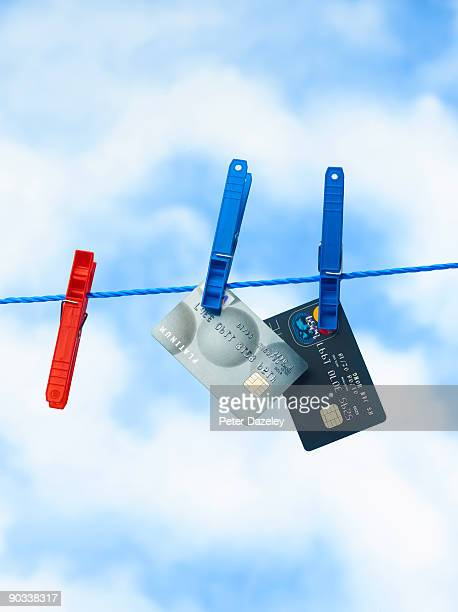 Credit cards on washing line.