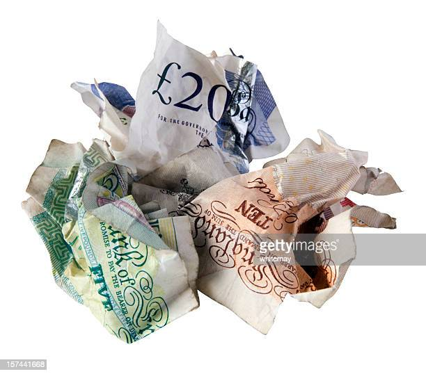 credit crunch - crumpled british bank notes - ten pound note stock photos and pictures