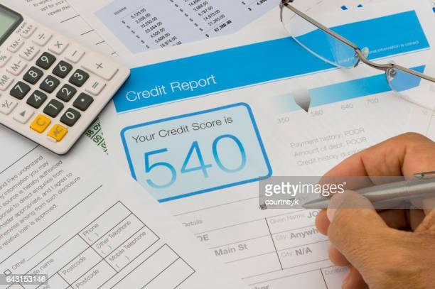 credit report form on a desk - negative emotion stock pictures, royalty-free photos & images