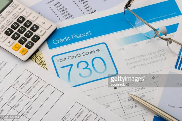 credit report form on a desk with other paperwork. - scoring stock pictures, royalty-free photos & images