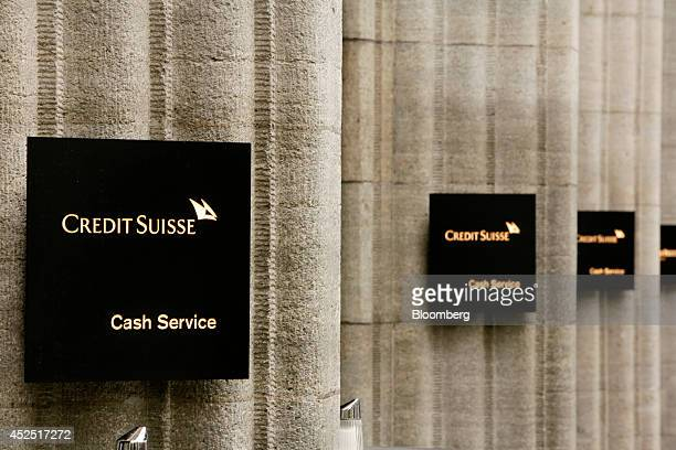 Credit Suisse cash service signs sit on display outside a Credit Suisse Group AG bank branch in Zurich Switzerland on Monday July 21 2014 Zurichbased...