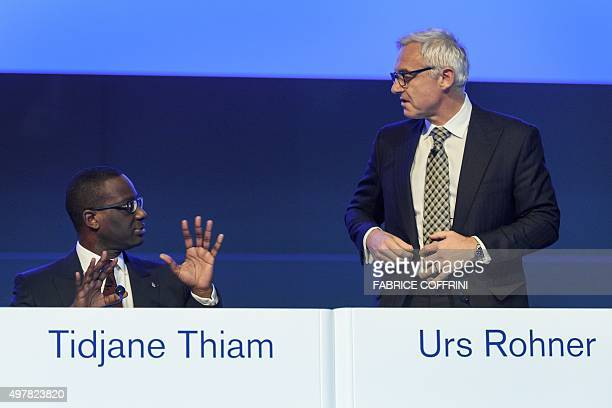Credit Suisse CEO Tidjane Thiam gestures next to Credit Suisse Chairman Urs Rohner prior to the start of an extraordinary shareholders meeting of the...
