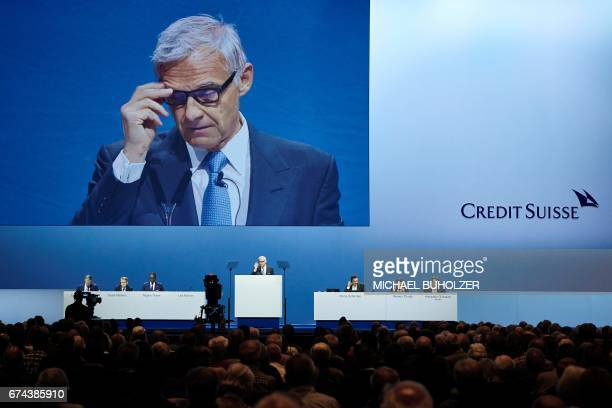 Credit Suisse chairman Urs Rohner gestures as he delivers a speech on stage during the annual shareholders' meeting of the Swiss banking group on...
