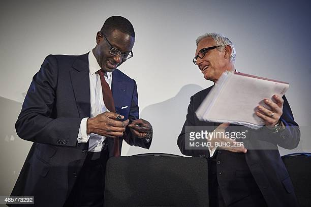 Credit Suisse designated CEO Tidjane Thiam and Credit Suisse Chairman Urs Rohner speak at the end of a press conference on March 10 2015 in Zurich...
