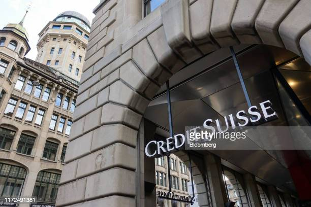 A Credit Suisse logo hangs in the entrance to a Credit Suisse Group AG bank branch in Zurich Switzerland on Sunday Sept 29 2019 Credit Suisse is...