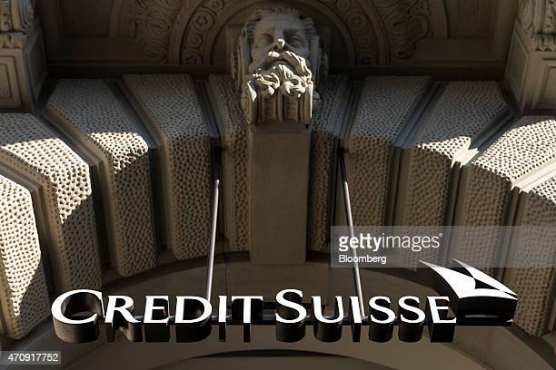 A Credit Suisse logo hangs in the entrance to Credit Suisse Group AG's headquarters in Zurich Switzerland on Friday April 24 2015 Investors are...