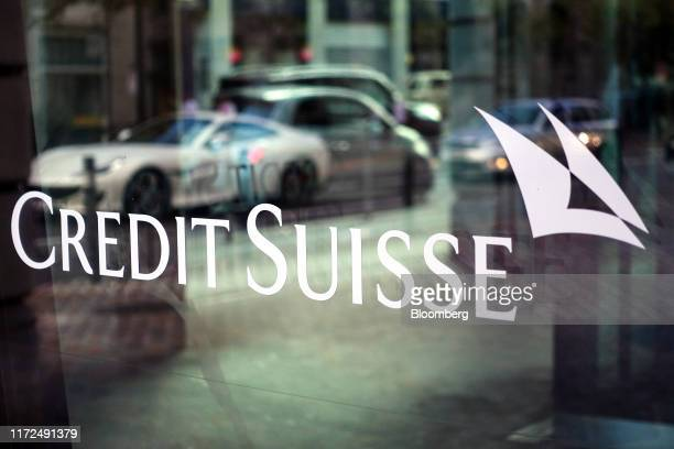 A Credit Suisse logo is displayed on the window of a Credit Suisse Group AG bank branch in Zurich Switzerland on Sunday Sept 29 2019 Credit Suisse is...