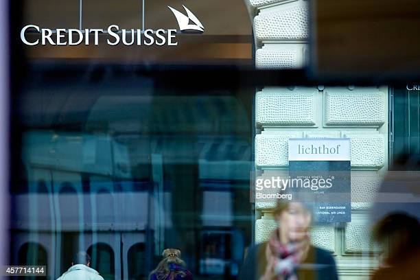 A Credit Suisse logo sits above the entrance to Credit Suisse Group AG's headquarters in Zurich Switzerland on Thursday Oct 23 2014 Credit Suisse...
