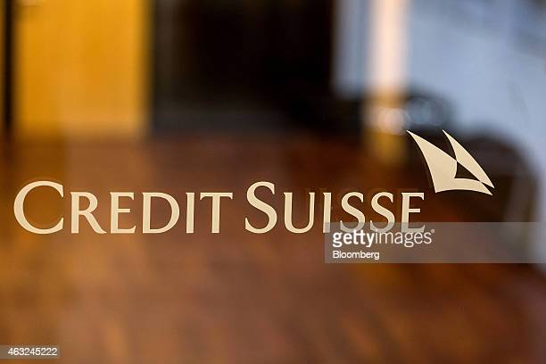 A Credit Suisse logo sits on a glass window pane at Credit Suisse Group AG's headquarters in Zurich Switzerland on Thursday Feb 12 2015 Credit Suisse...