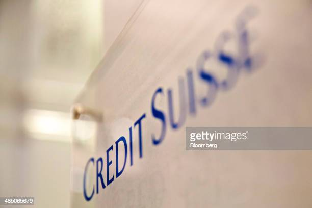 A Credit Suisse logo sits on a sign outside Credit Suisse Group AG's headquarters in Zurich Switzerland on Wednesday April 16 2014 Credit Suisse the...
