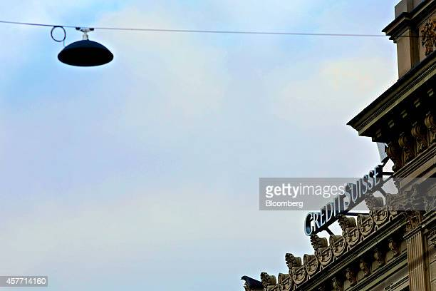A Credit Suisse logo sits on the roof of Credit Suisse Group AG's headquarters in Zurich Switzerland on Thursday Oct 23 2014 Credit Suisse...