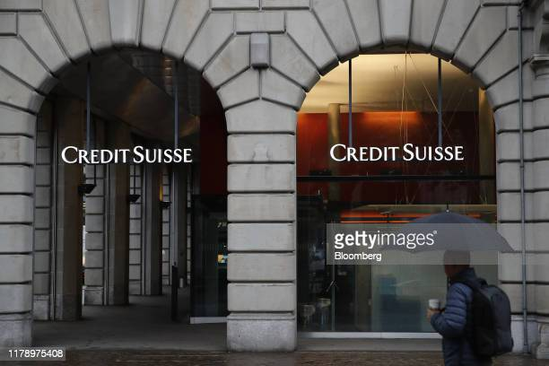 Credit Suisse logos hang in the entrance to a Credit Suisse Group AG bank branch in Zurich Switzerland on Wednesday Oct 30 2019 Credit Suisses...
