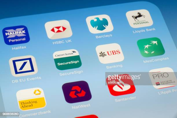credit suisse, ubs and other banking apps on ipad screen - bank icon stock photos and pictures
