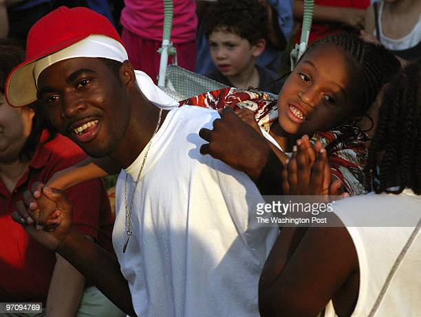 Tetona Dunlap/TWP WHEATON MD Achilles Modouho left and Alex Solis dance to the music of Milkshake Monday July 4 2005 at the Wheaton Sparkles...