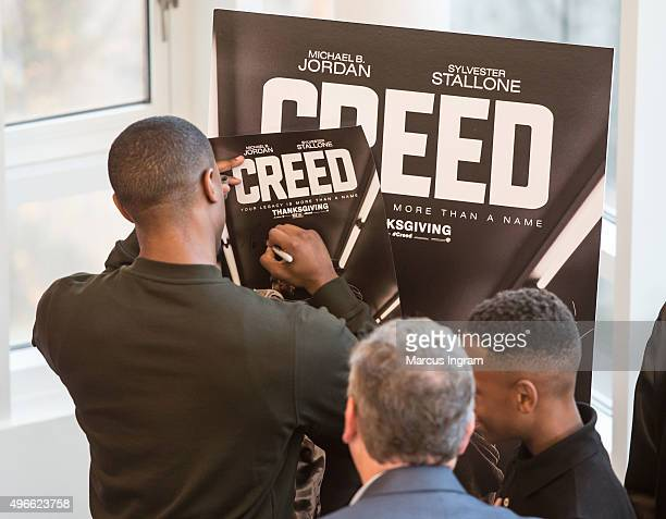 'Creed' actor Michael B Jordan signing autographs during Big Brothers Big Sisters of Metro Atlanta mural unveiling on November 10 2015 in Atlanta...