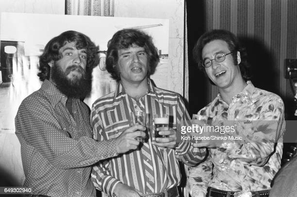 Creedence Clearwater Revival drink a toast at press conference February 1972