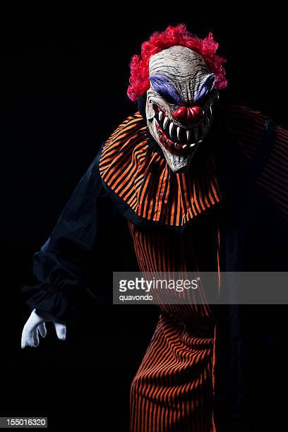 creepy adult clown halloween costume portrait on black - scary clown makeup stock photos and pictures