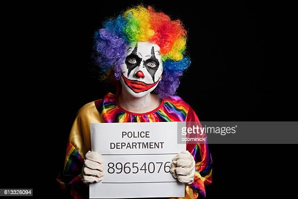 creepy clown mugshot - clown stock-fotos und bilder