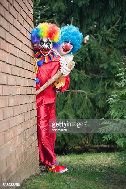 Creepy Clowns Peeking Around A Corner