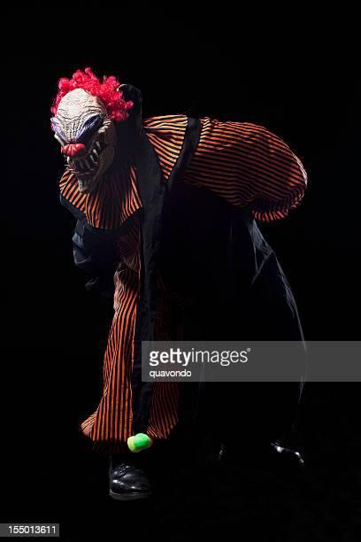 Creepy Halloween Clown Costume Portrait on Black, Copy Space