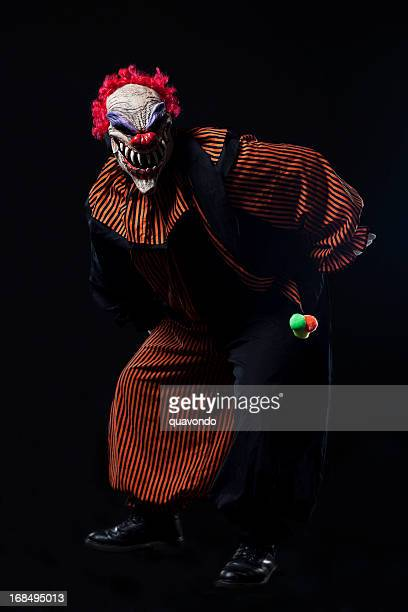 Creepy Halloween Clown Costume Portrait on Black