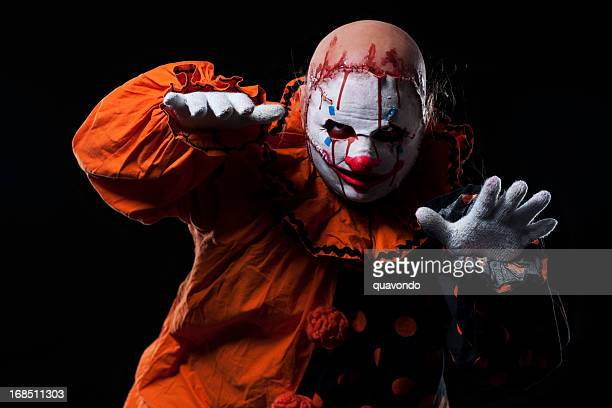 creepy halloween clown in bloody mask, portrait on black - scary clown makeup stock photos and pictures