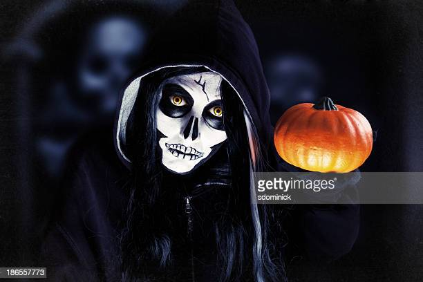 creepy halloween skeleton holding pumpkin - scary pumpkin faces stock photos and pictures