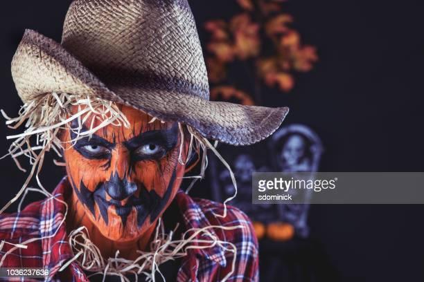 creepy jack o' lantern scarecrow close up - scarecrow faces stock photos and pictures