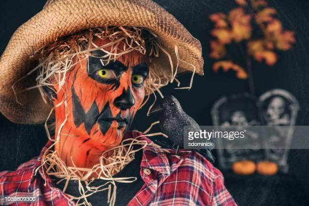 creepy jack o' lantern scarecrow close up - scary pumpkin faces stock photos and pictures