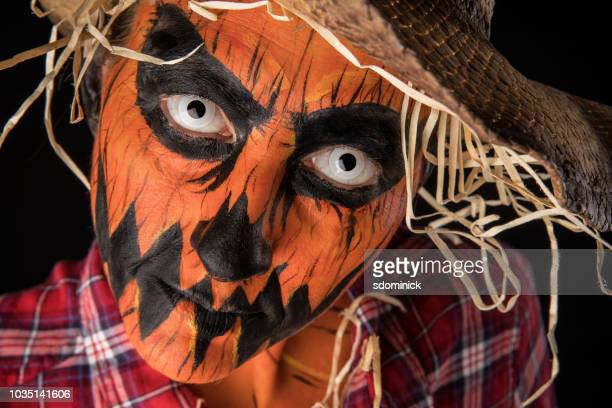 creepy jack o'lantern scarecrow halloween make up - scarecrow agricultural equipment stock photos and pictures