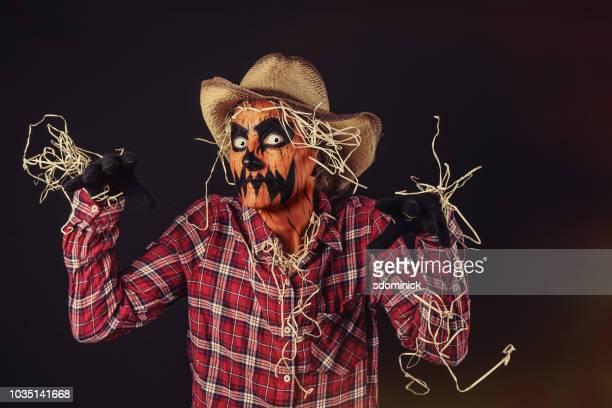 creepy jack o'lantern scarecrow - scarecrow faces stock photos and pictures