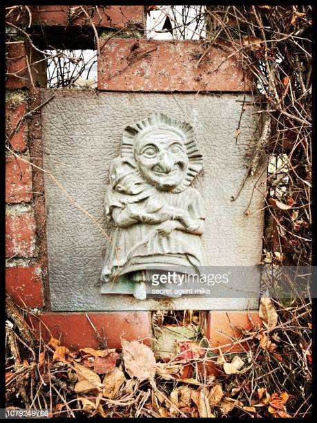 creepy tile in fence - symbolism stock pictures, royalty-free photos & images