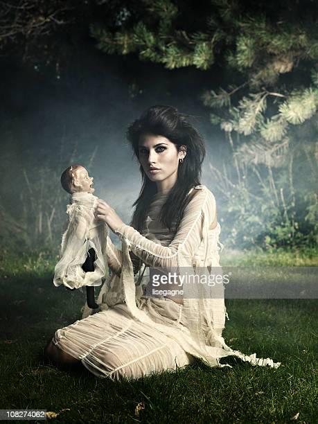 Creepy woman and doll