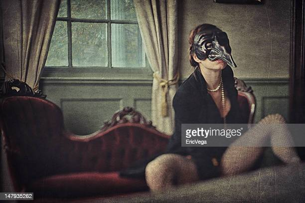 creepy woman wearing a bizarre mask - fetish wear stock photos and pictures