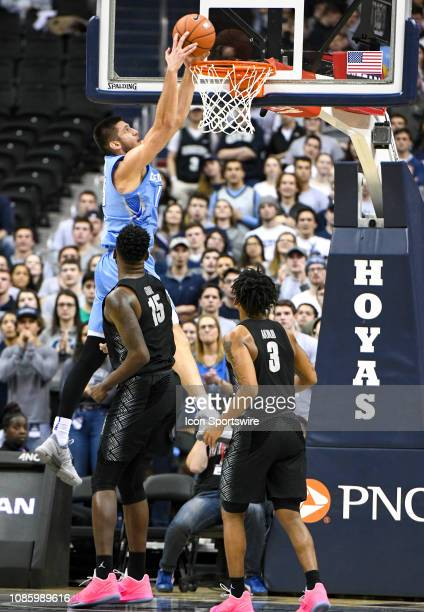 Creighton Bluejays forward Martin Krampelj dunks the ball in the second half against Georgetown Hoyas center Jessie Govan on January 21 at the...