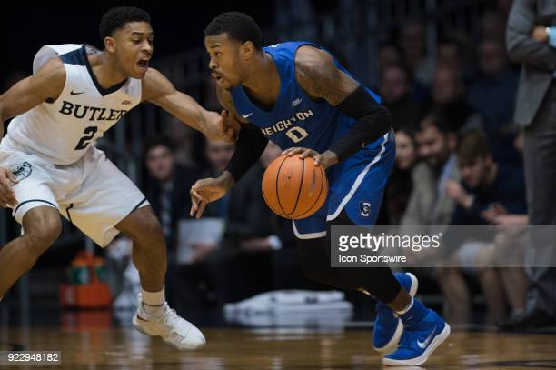 Creighton Bluejays guard MarcusFoster drives to the basket against Butler Bulldogs guard AaronThompson during the men's college basketball game...