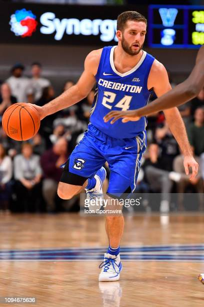 Creighton Bluejays guard Mitch Ballock looks for a way past Villanova Wildcats forward Dhamir CosbyRoundtree during the college basketball game...