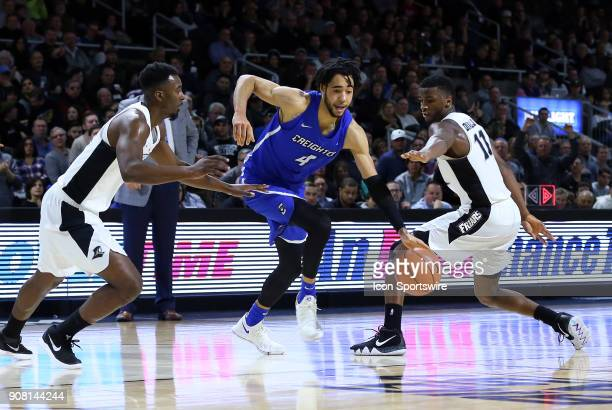 Creighton Bluejays guard Ronnie Harrell Jr drives to the basket between Providence Friars guard Isaiah Jackson and Providence Friars guard Alpha...