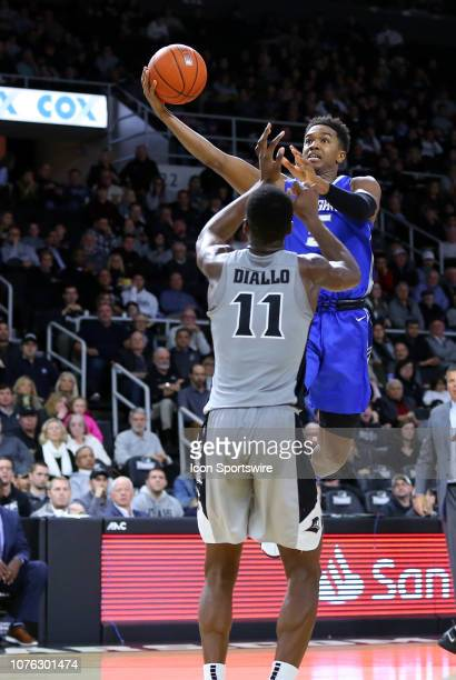Creighton Bluejays guard TyShon Alexander shoots over Providence Friars guard Alpha Diallo during a college basketball game between Creighton...