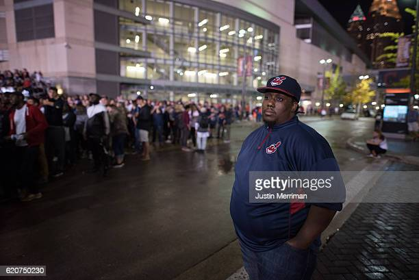 Creighton Johnson of Cleveland reacts as he watches the final inning of the game outside of Progressive Field during game 7 of the World Series...