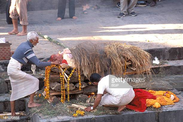 Cremation Cremation on the ghats steps that cover the shores or banks of the river along the holy river Bagmati in Pashupatinath The faithful bring...
