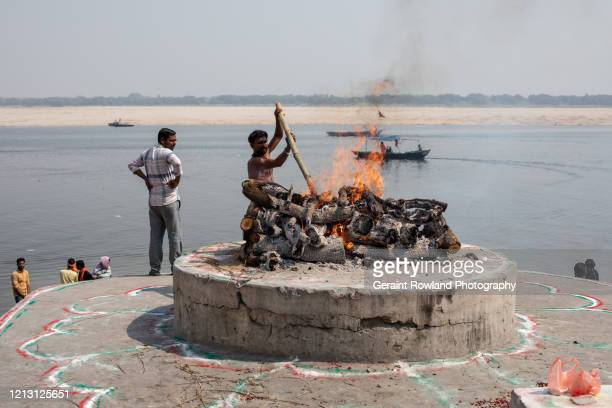 cremation ghats of varanasi - stoking stock pictures, royalty-free photos & images