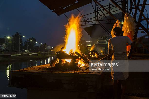Cremation of a dead body at the burning ghats of Pashupatinath temple at the banks of Bagmati River