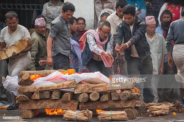 cremation on bagmati riverbank near the pashupatinath temple, kathmandu, nepal - hinduism stock pictures, royalty-free photos & images