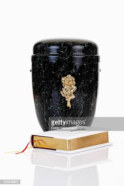 cremation urn and bible - urn stock pictures, royalty-free photos & images