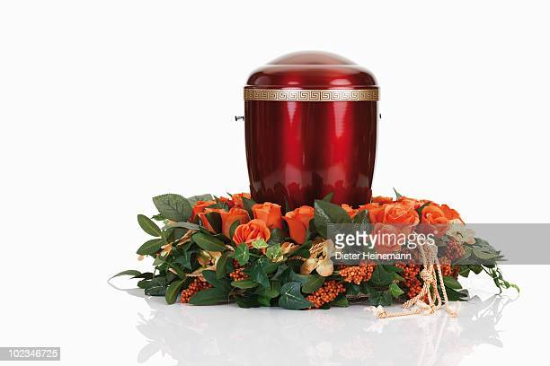 cremation urn with floral wreath - urn stock pictures, royalty-free photos & images