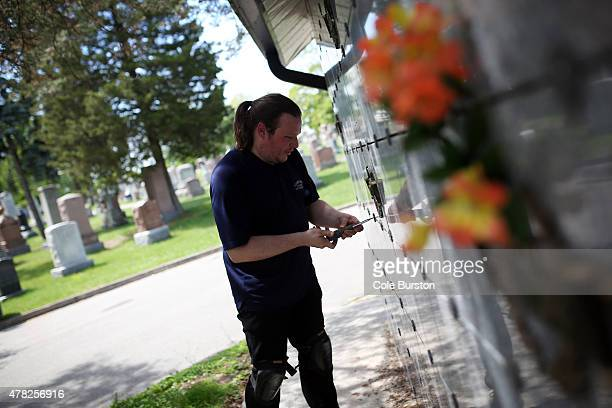Crematorium technician Jonathan Prideaux opens an unmarked niche where normally a marked niche houses families' cremated loved ones at the St. John's...